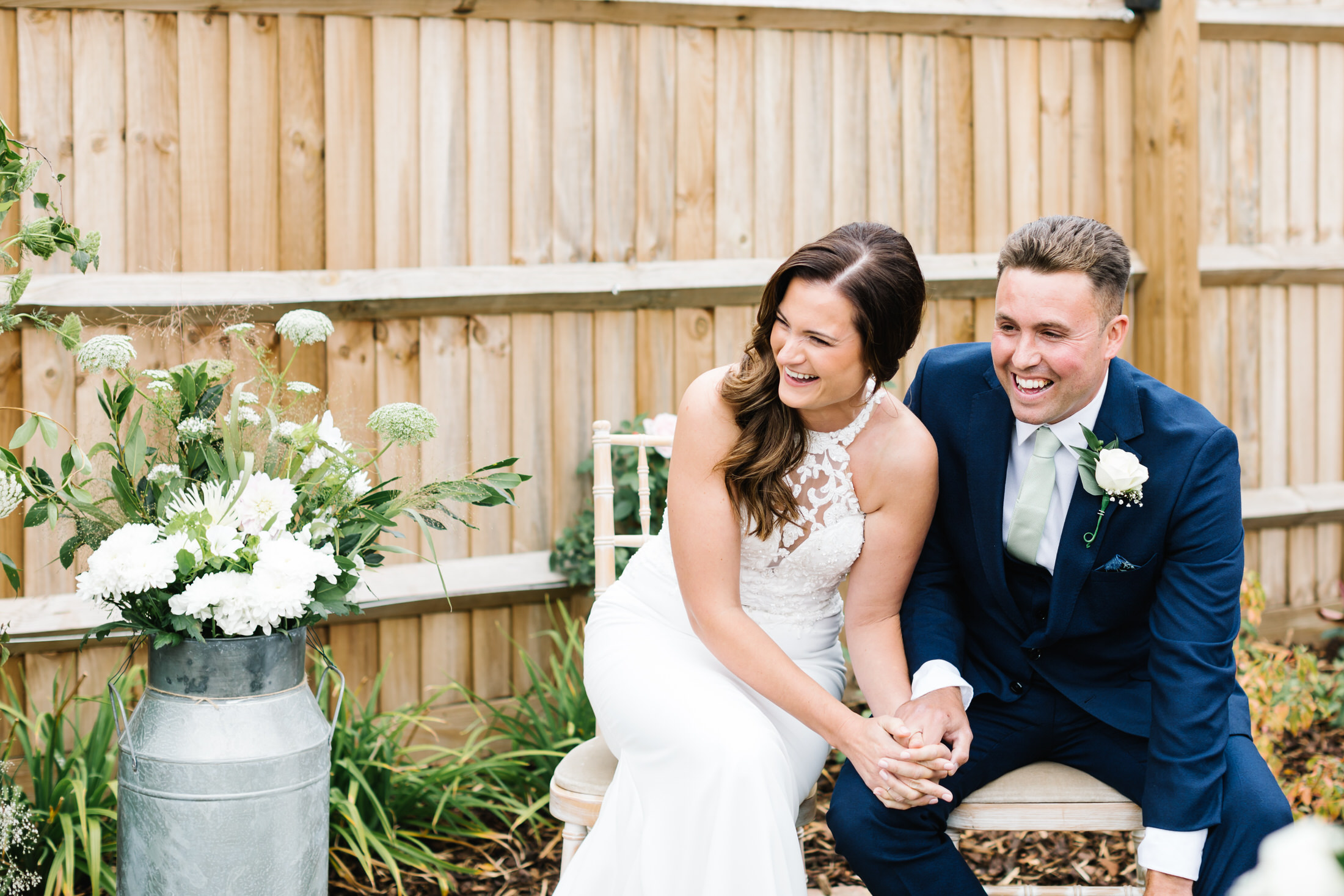 how to plan a back garden wedding couple laughing during ceremony in their garden at home