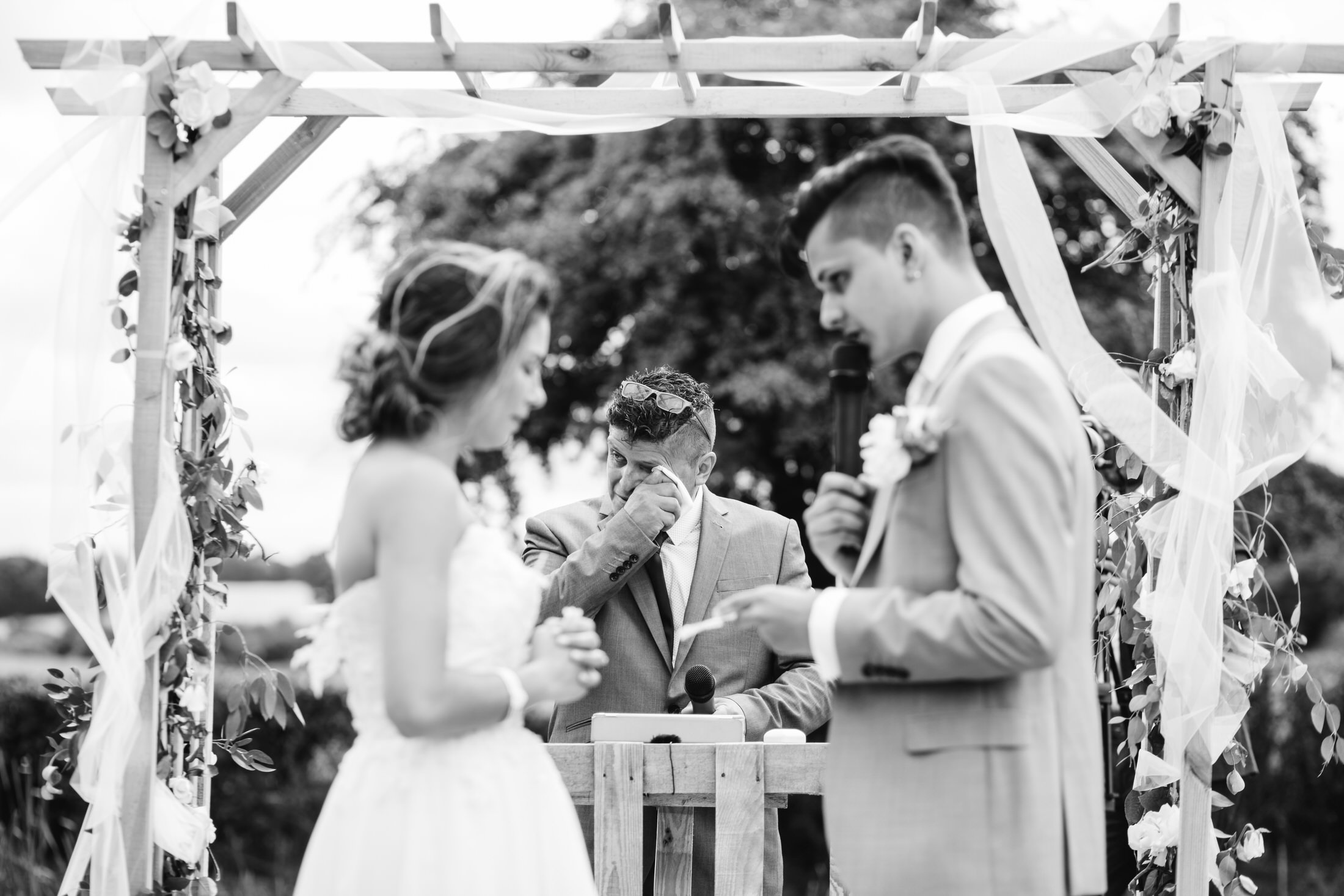 how to plan a back garden wedding dad cries while marrying his son and the couple read their vows to each other