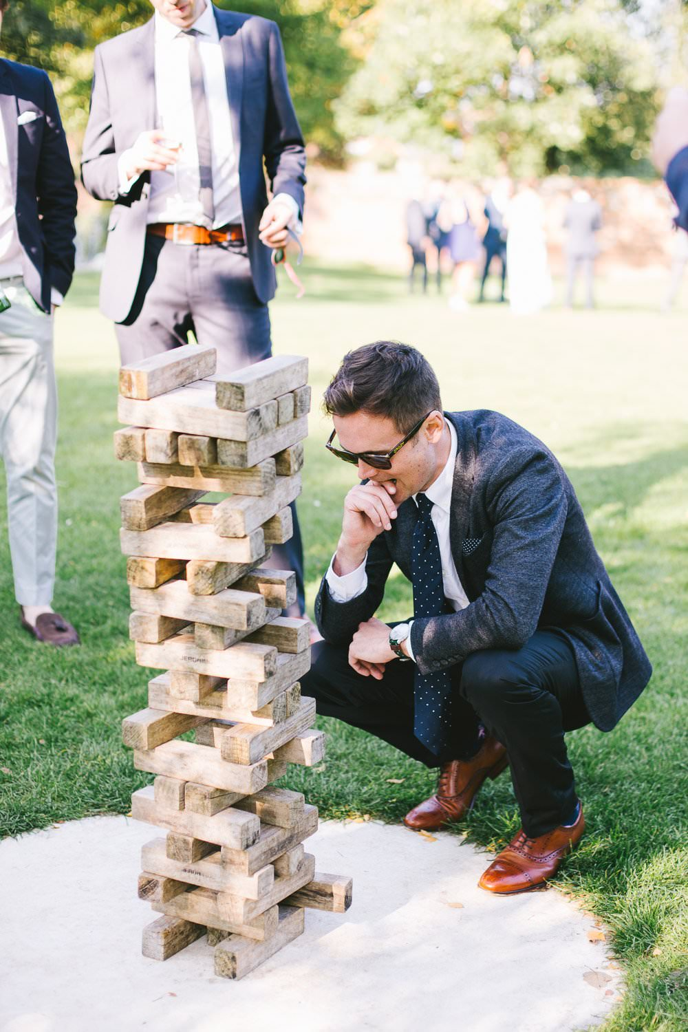 wedding guest playing jenga st albans wedding photographer